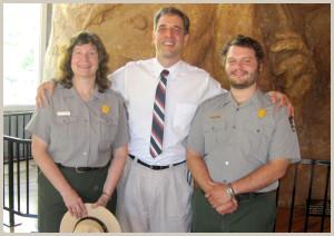 Superintendent Cheyrl Schreier, Lou Del Bianco and Sculptor in Residence Dustin Baker